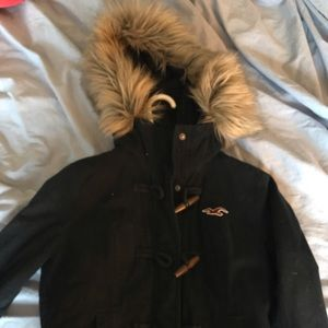 Faux fur Hollister coat with fuzzy interior.